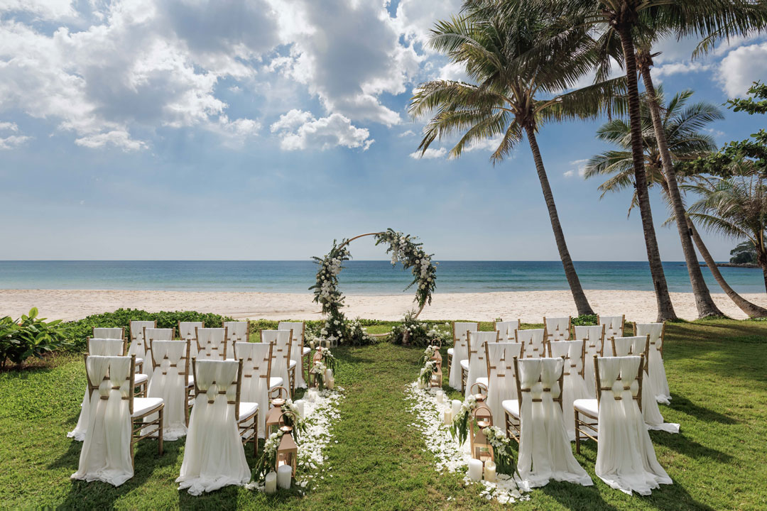 Destination Weddings WA outdoor ceremony white chairs arch and lawn